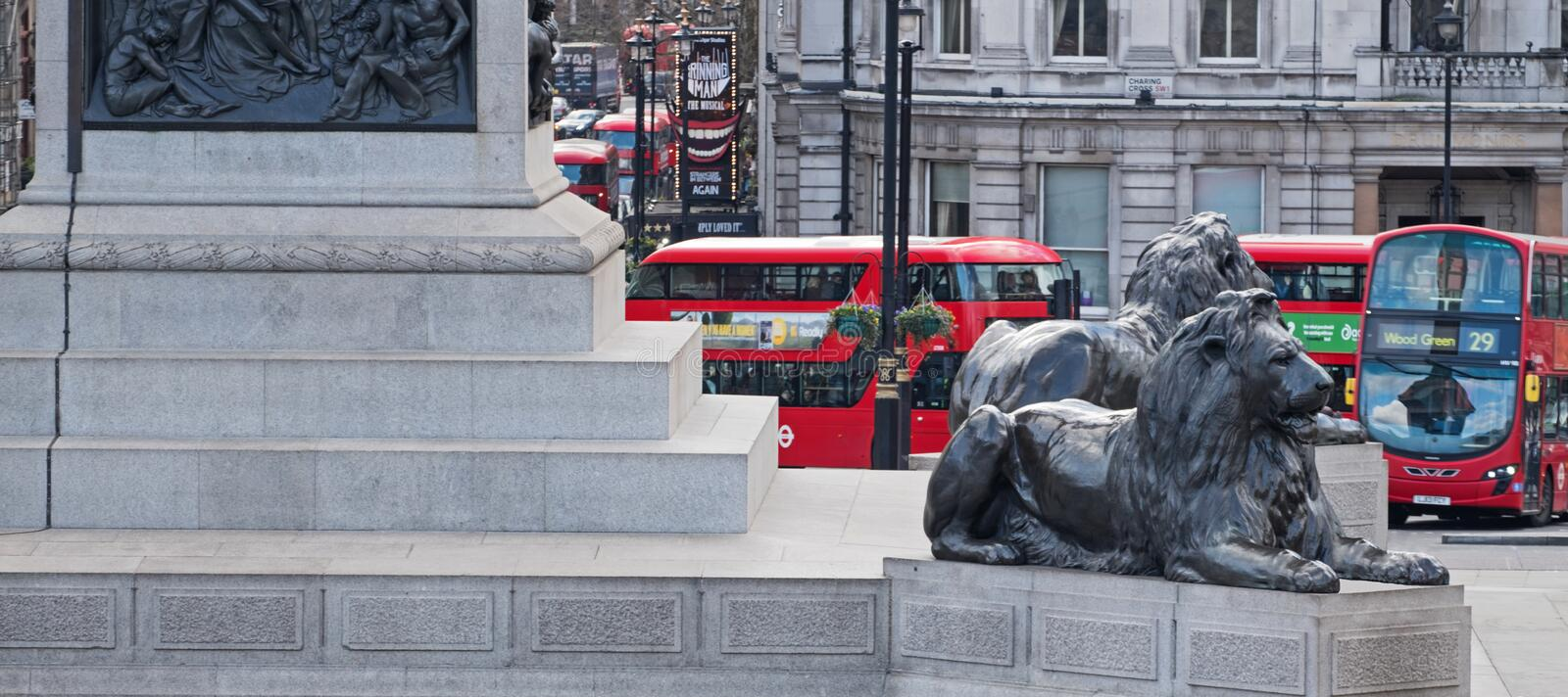 Lions and buses in central London stock photos