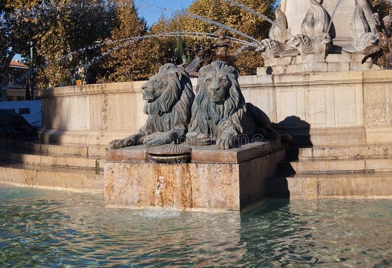 Lions of Fountain Rotonde (1860). Aix-en-Provence, France. Sculptures of lions (part of the Fountain Rotonde, circa 1860). Architect Theophile de Tournadre. Aix royalty free stock photos