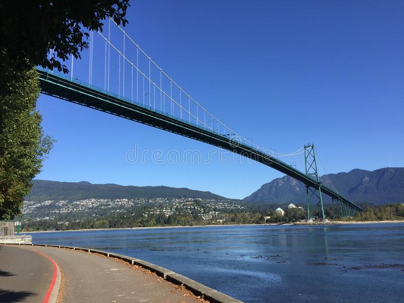 Lions Gate Bridge viewed from Stanley Park Seawall royalty free stock photography