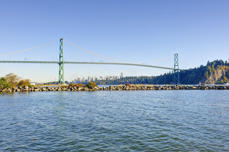 Lions gate bridge from West Vancouver, Canada - with Vancouver city center in the background and a jetty in the foreground. BC, Canada royalty free stock image