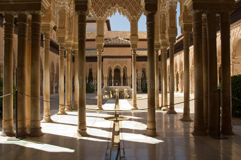 Lions Patio in Alhambra. The celebrated Patio de los Leones (Court of the Lions) is an oblong court, 116 ft (35 m) in length by 66 ft (20 m) in width, surrounded stock photo