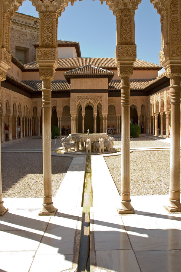 Lions Patio in Alhambra. The celebrated Patio de los Leones (Court of the Lions) is an oblong court, 116 ft (35 m) in length by 66 ft (20 m) in width, surrounded stock images