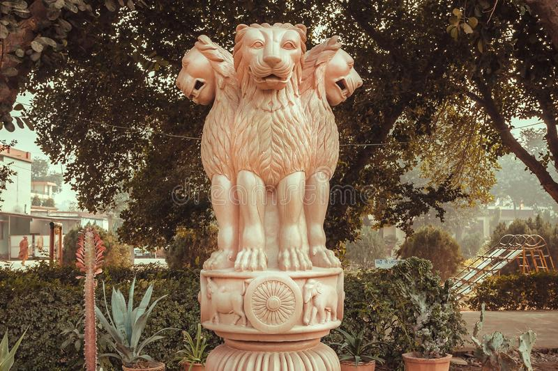 Lions on sculptured national emblem of India. Copy of the ancient Ashoka Pillar of Sarnath.  royalty free stock photo