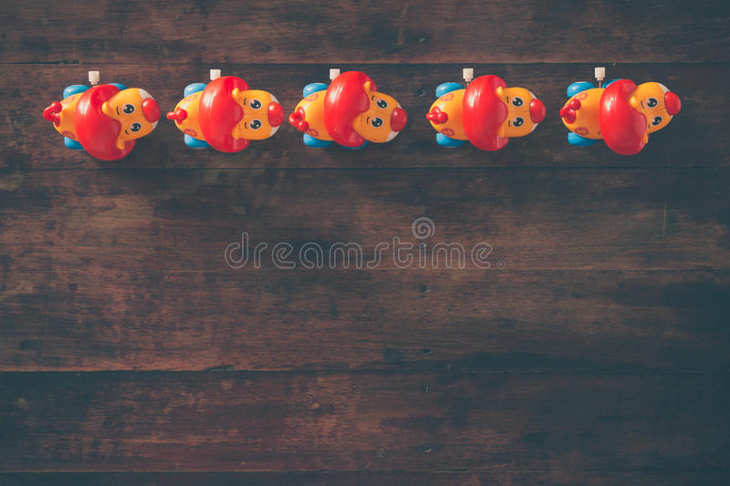 Lions. Wind up toy lions on wooden table background stock photo