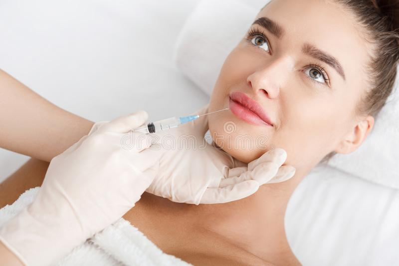 Lip Augmentation. Young Woman Receiving Hyaluronic Acid royalty free stock image
