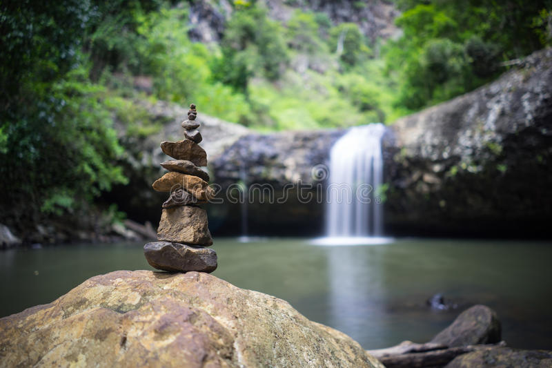 Lip Falls Beechmont Australia. The Lip waterfalls in Beechmont in Queensland in Australia. Image taken in long exposure shot ans with a standing stone formation stock photo