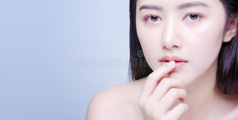 Lip Protection. Closeup of Beautiful Young Asian Woman Healthy Lips. Female Model Touching Her Plush Mouth With Smooth Perfect stock photography