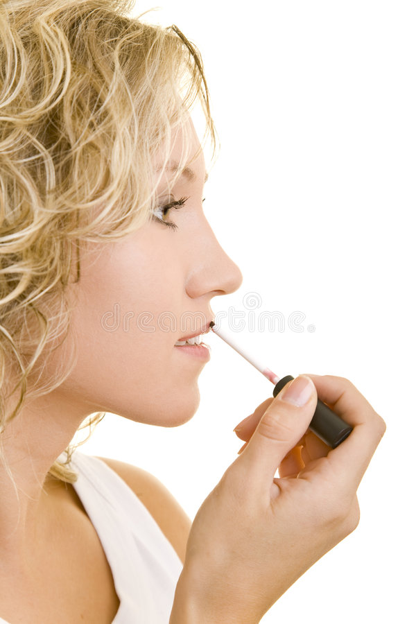 Lipgloss on the lips stock photography