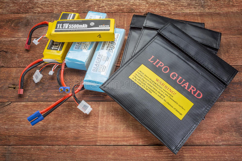 LiPO batteries and protective charging bags. Fort Collins, CO, USA - March 19, 2015: LiPo (lithium polymer) batteries used in drones and RC model with protective stock photo