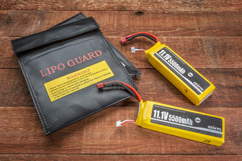 LiPO batterires with protective charging bags. Fort Collins, CO, USA - March 18, 2015: LiPo (lithium polymer) batteries used in drones and RC model with royalty free stock images