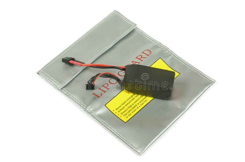 LiPo battery guard bag for safety battery charging. LiPo Lithium polymer batteries can be dangerous during charging and overcharging. This bag offers safety and stock image