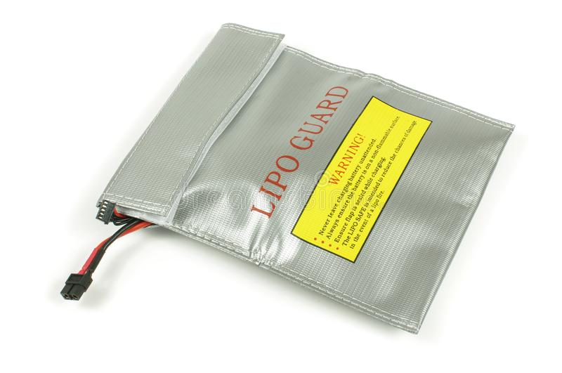 LiPo battery guard bag for safety battery charging. LiPo Lithium polymer batteries can be dangerous during charging and overcharging. This bag offers safety and stock photo