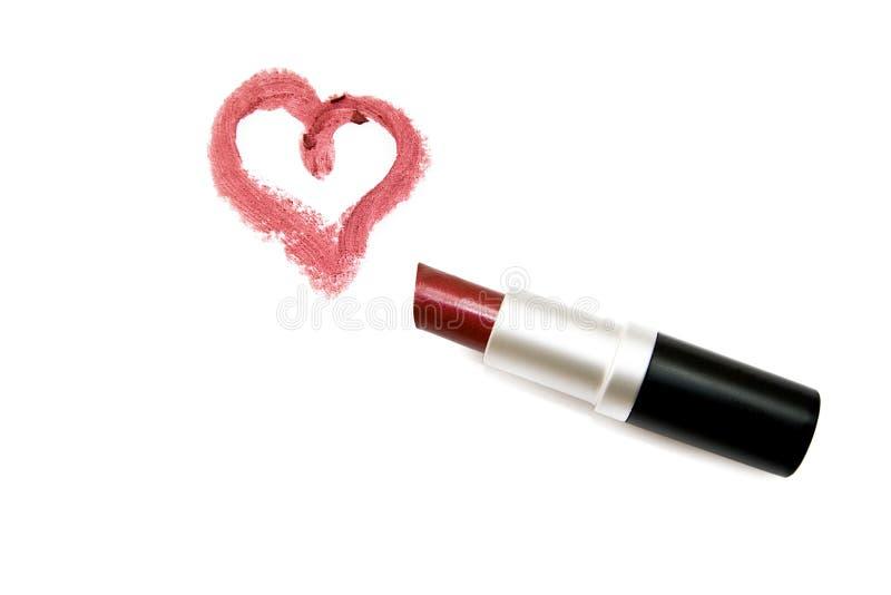 Lippenstift en hart stock afbeeldingen
