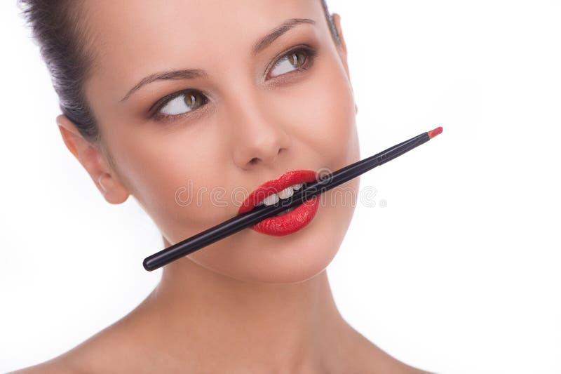 Lippenstift in haar mond. stock afbeeldingen