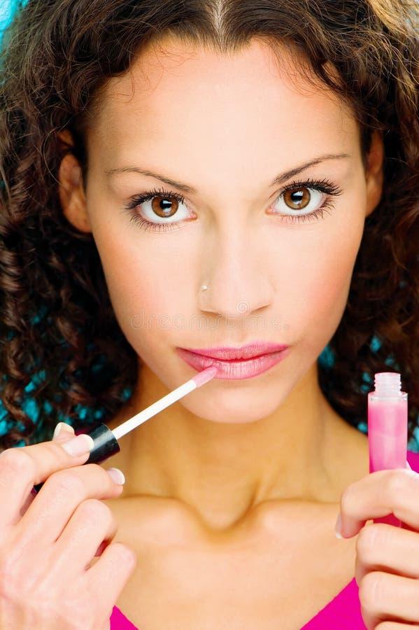 Lippenstift op haar lippen royalty-vrije stock fotografie