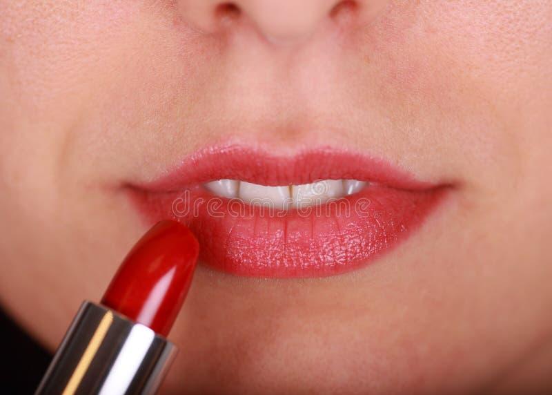 Lippenstift und Lippe stockfotos