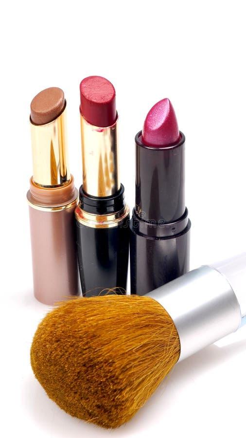 Lippenstiften en borstel royalty-vrije stock afbeelding
