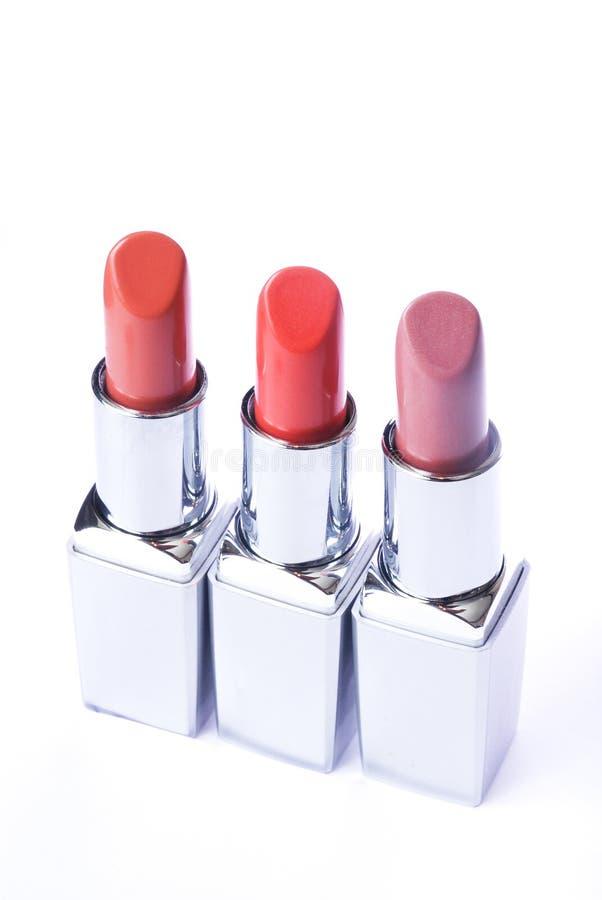 Lippenstiften van verschillende kleuren stock fotografie