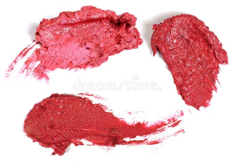 Lippenstiftslagen op wit worden geïsoleerd dat stock afbeeldingen
