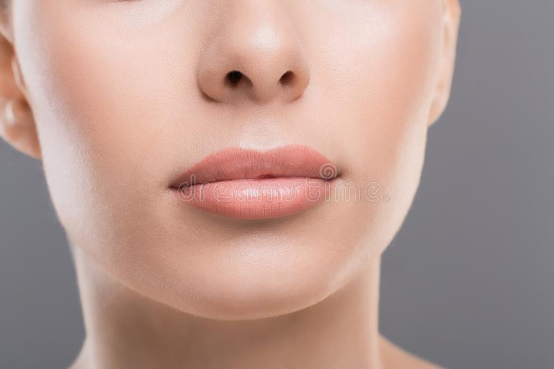 Close up of perfect female lips, permanent makeup concept. Lips beauty. Close up of perfect female face, permanent makeup concept stock photography