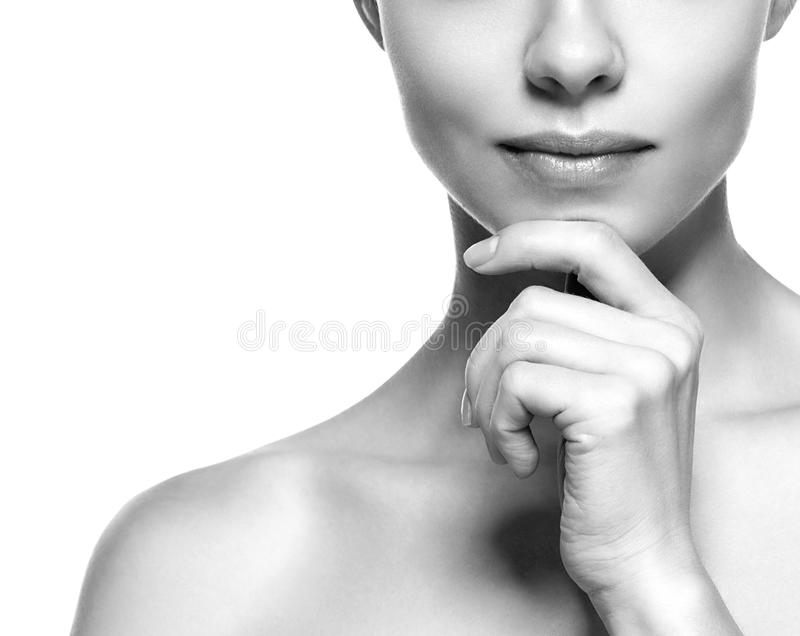 Lips and cheen. Beauty Woman face Portrait. Black and white. Beautiful model Girl with Perfect Fresh Clean Skin. Youth and Skin Care Concept stock photography