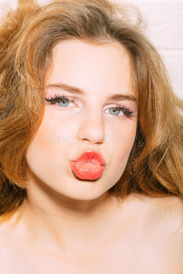 Lips concept. Woman with pretty lips. Girl blow red lips kiss. Dress your lips in brand.  royalty free stock images