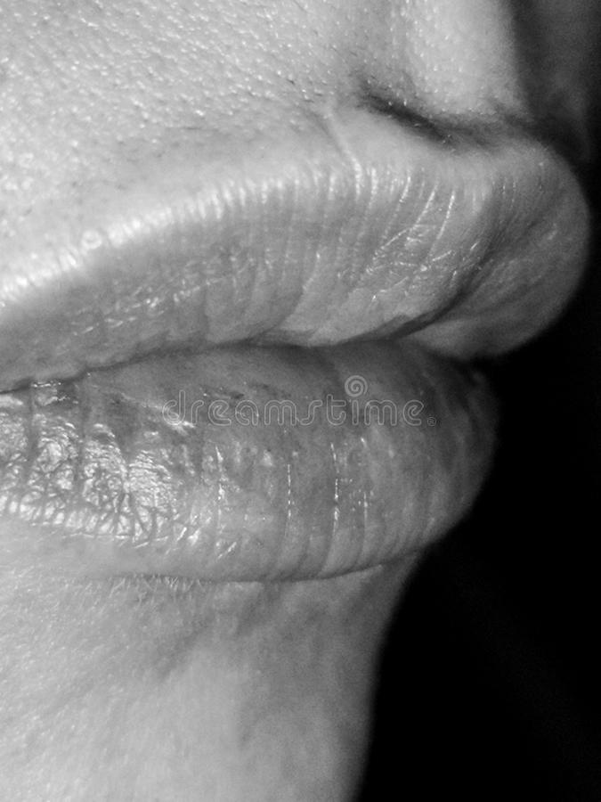 Lips of the girl in black and white stock images