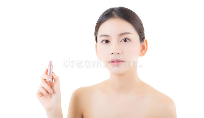 Lips makeup asian woman with lip balm care. Beauty Asian girl holding lipstick with happy. Cosmetics beauty concept stock photo