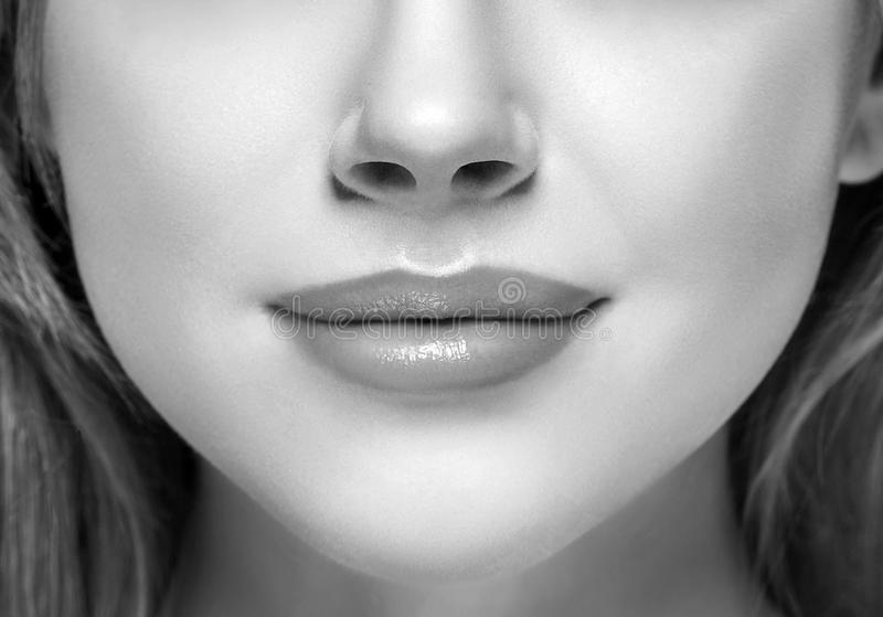 Download lips and nose woman happy young beautiful studio portrait black and white stock photo