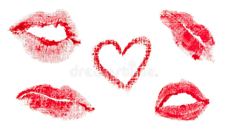 Lips prints. Red lipstick lips prints. Heart shape and kiss mark. Isolated object stock photo