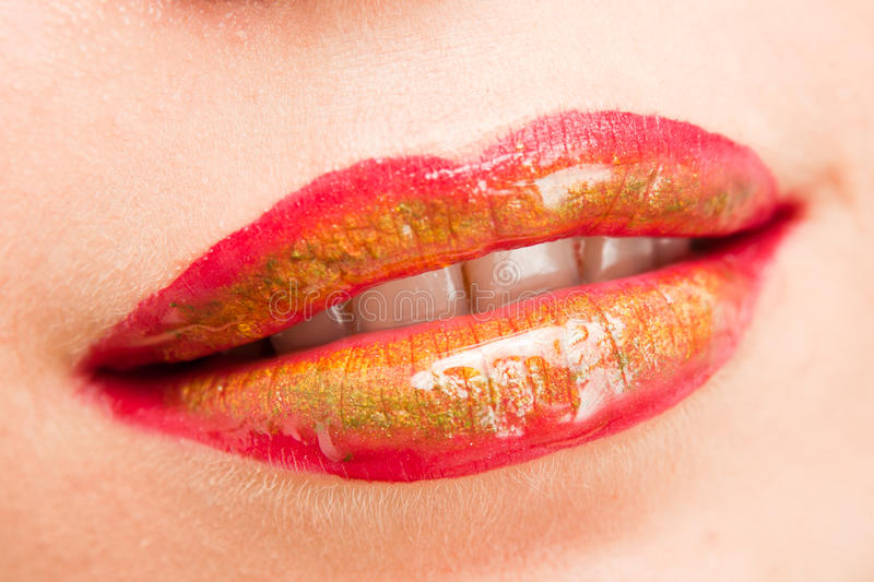 Lips With Red, Green And Yellow Lipstick Royalty Free Stock Images