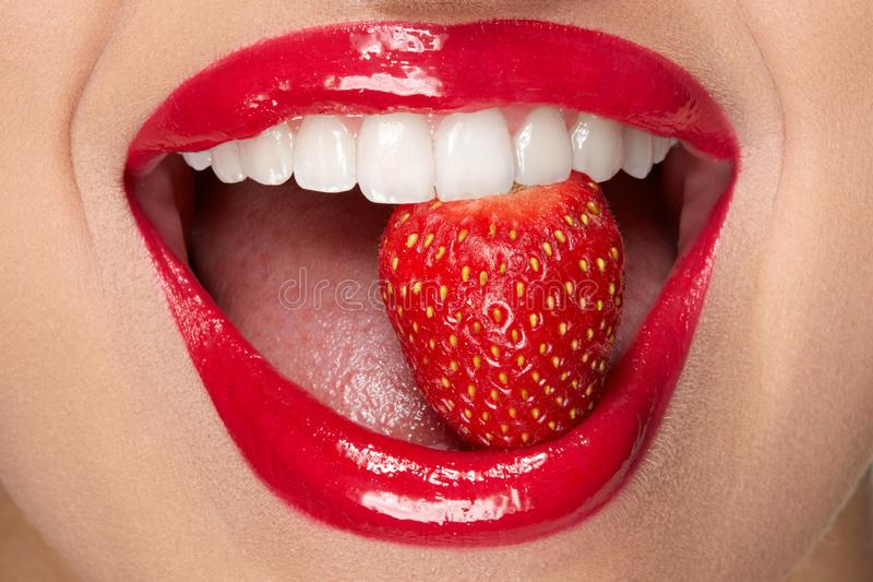 Lips. Woman With Red Lipstick And Strawberry royalty free stock photo