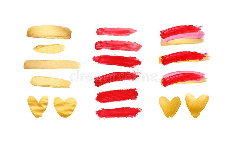 Set of gold and red strokes isolated on white background. Lipstick bullet smudged. Beautiful textured brush strokes and royalty free stock photo