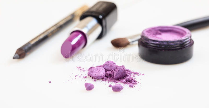 Lipstick and eye shadow isolated on white background stock illustration