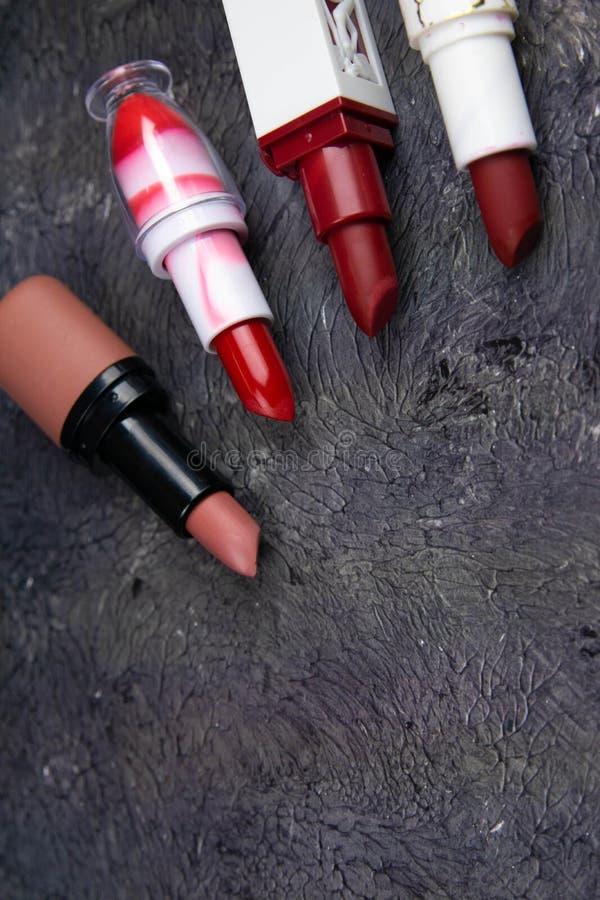 Lipstick. Fashion Colorful Lipsticks over black background. Lipstick tints palette, Professional Makeup and Beauty stock photo