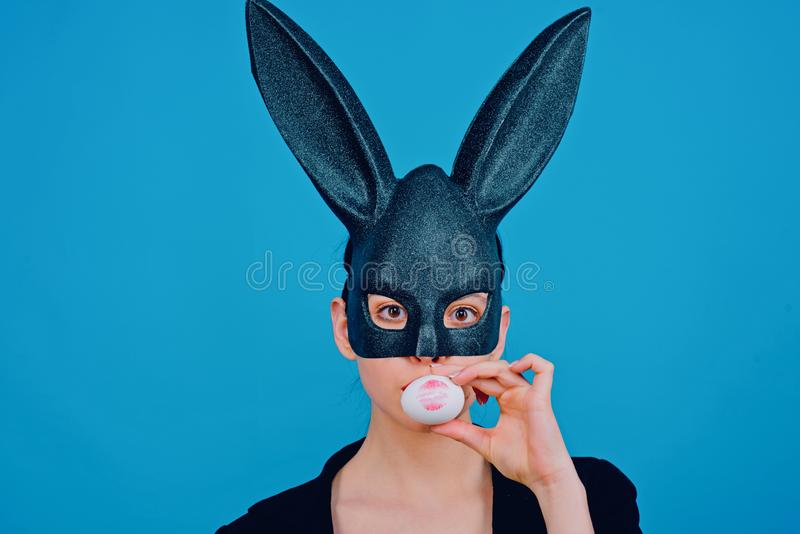 Lipstick kiss print on easter egg. Happy easter. Girl with lace bunny ears. Bunny woman. Easter bunny woman, rabbit and stock images