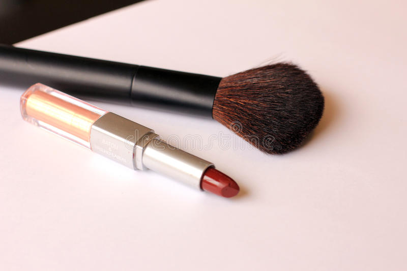 Lipstick and make up brush stock photos
