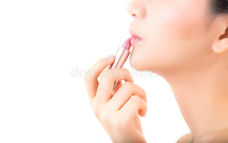 Lipstick makeup asian woman with lip balm care. Beauty Asian girl on lips with happy. Cosmetics beauty concept stock photo
