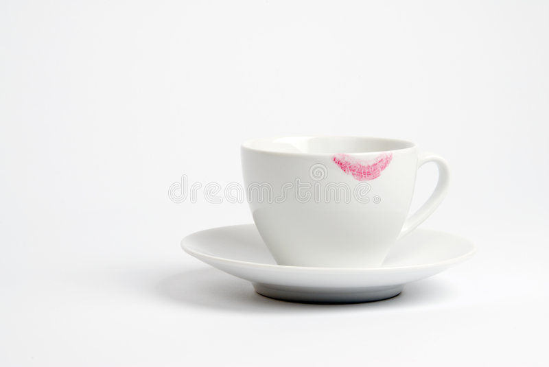 Lipstick Mark on Coffee Cup. Bright pink lipstick mark on a white coffee cup royalty free stock images