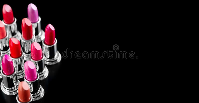 Lipstick. Professional makeup and beauty. Lipstick tints palette closeup. Colorful lipsticks over black royalty free stock photography