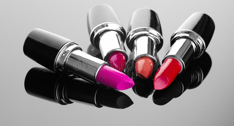 Lipstick. Professional makeup and beauty. Lipstick tints palette closeup. Colorful lipsticks over black royalty free stock photos