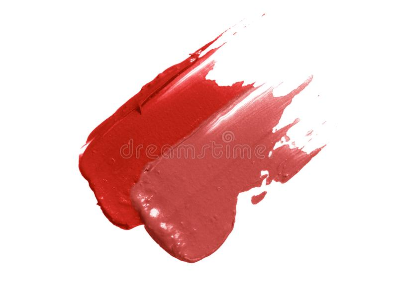 Lipstick smear smudge swatch. Creamy makeup texture. Red and nude lip stick diagonal strokes isolated on white background.  royalty free stock image