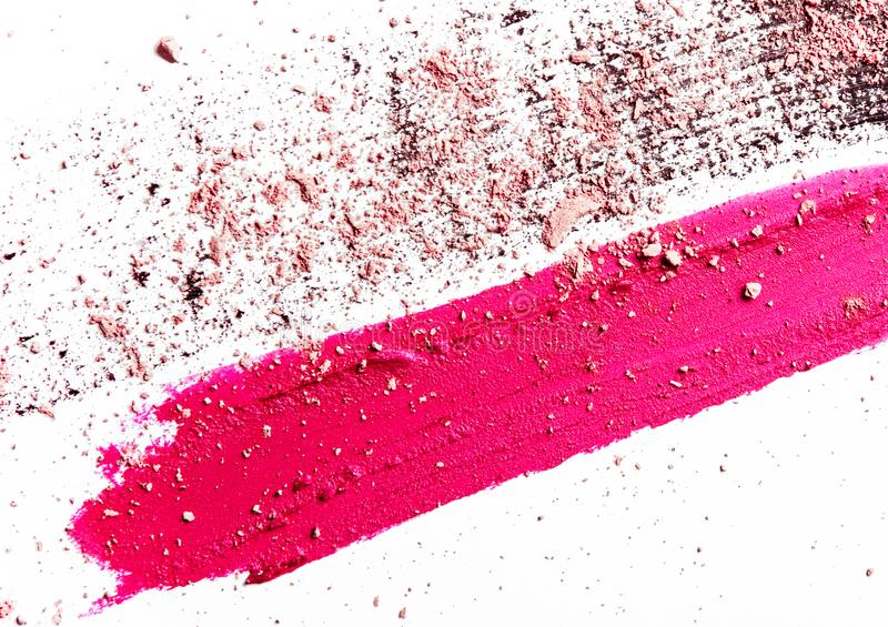 Lipstick smudge, mascara stroke and crushed eyeshadow isolated on white background. Beauty texture, cosmetic product and art of make-up concept - Lipstick smudge royalty free stock photos