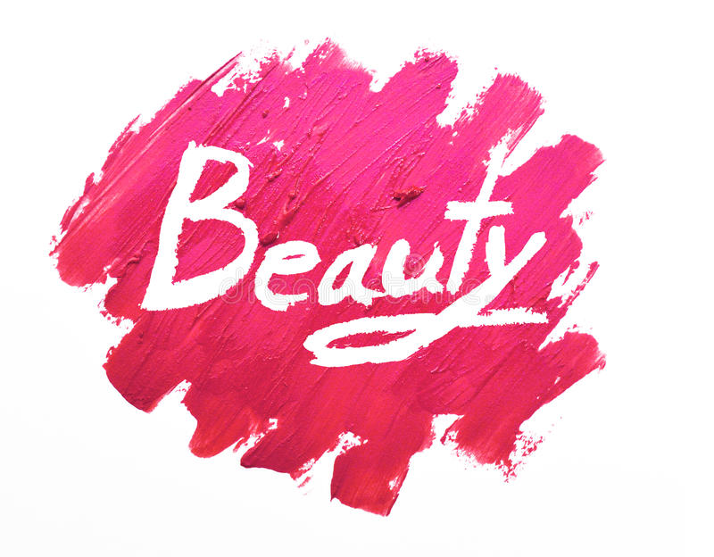 Lipstick smudged on white background with Beauty. Text royalty free stock image