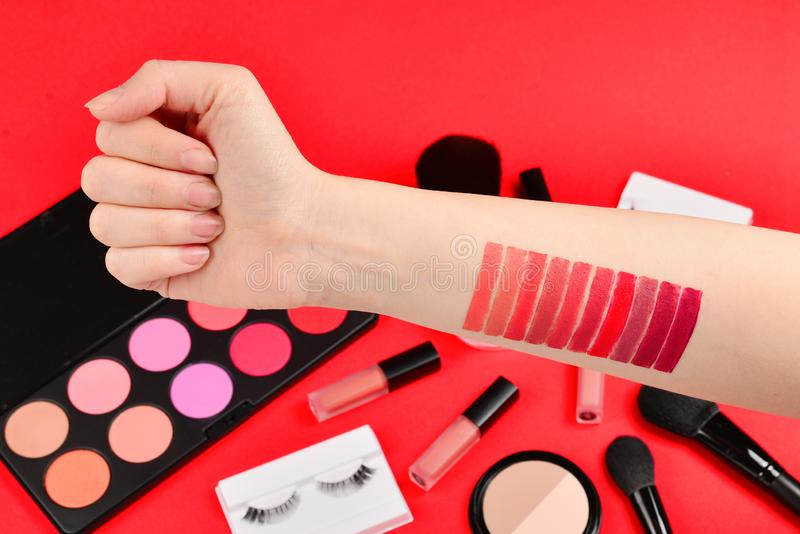 Lipstick swatches on woman hand. Professional makeup products with cosmetic beauty products, foundation, lipstick,  eye shadows, stock images