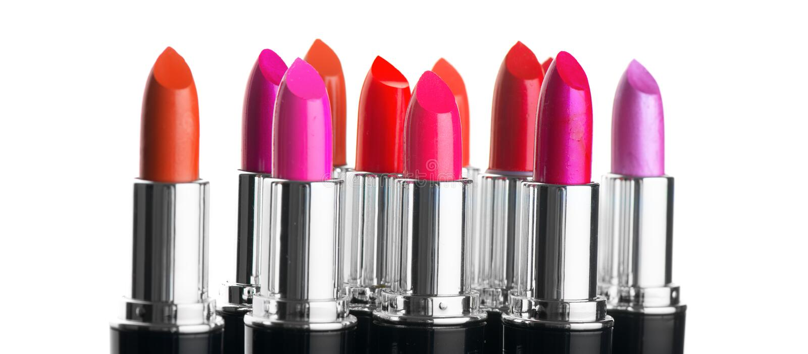 Lipstick tints palette. Fashion colorful lipsticks over white background. Professional makeup stock images