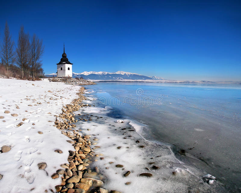 The Liptovska Mara lake frozen with ice stock photos