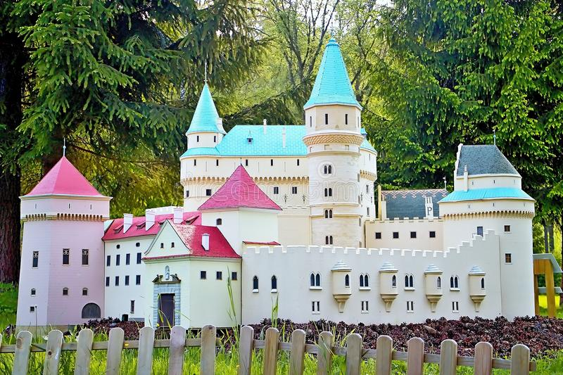 Liptovsky Jan, Slovakia - May 28. 2017: Miniature of the Bojnice Chateau in the ratio 1 : 25. Beautiful Slovakia. Castle, fence, trees and grass royalty free stock images