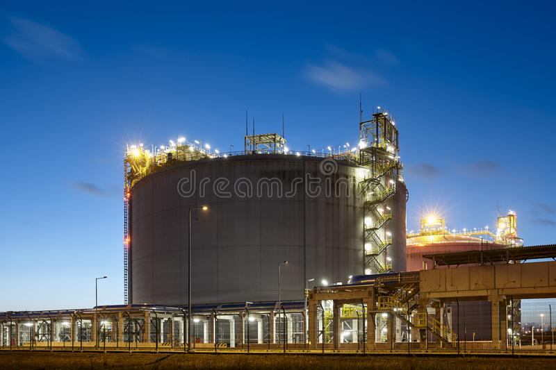 Liquefied natural gas storage tank at dusk royalty free stock photography