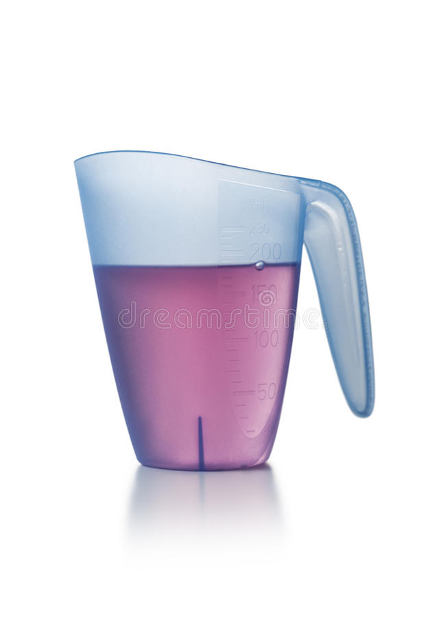 Liquid Chemical in a Measuring Cup royalty free stock photography